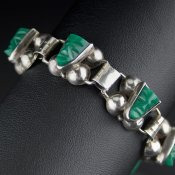 Coco and Benny 1940's Sterling Silver Carved Green Oynx Repoussé Vintage Bracelet